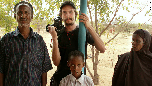 Two Swedish journalists, including Johan Persson, pictured with camera, were found guilty of supporting terrorism in Ethiopia.