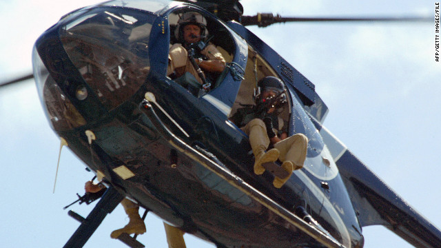 Members of the US private security company Blackwater patrol over Baghdad 15 April 2004.