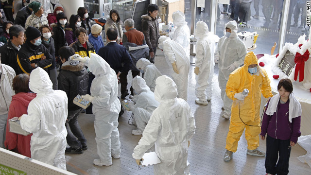 Evacuees from the west side of Fukushima receive radiation scans in this photo taken in March.