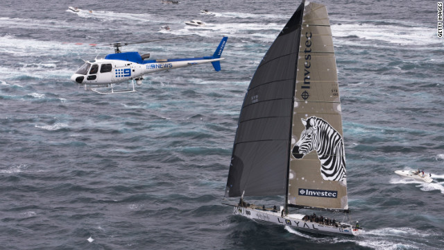 A television helicopter tracks Investec Loyal during the Sydney-Hobart yachting classic. Their line honors victory is under protest.
