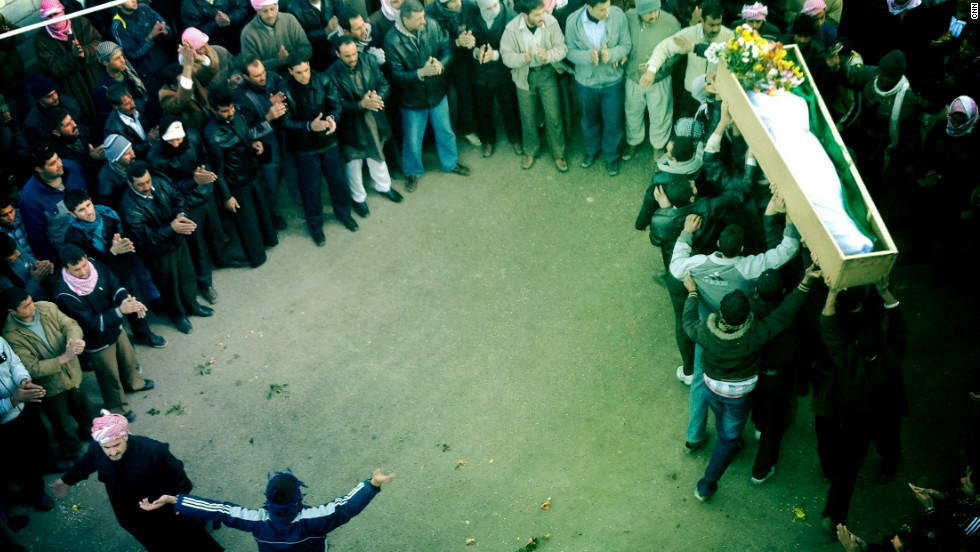 "A funeral procession takes place in Dar Kabir in Homs for ""Malik,"" who was killed by government forces."
