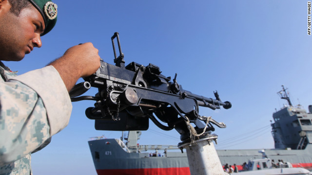 An Iranian Army soldier takes part in naval exercises in the Strait of Hormuz in southern Iran on December 28, 2011.