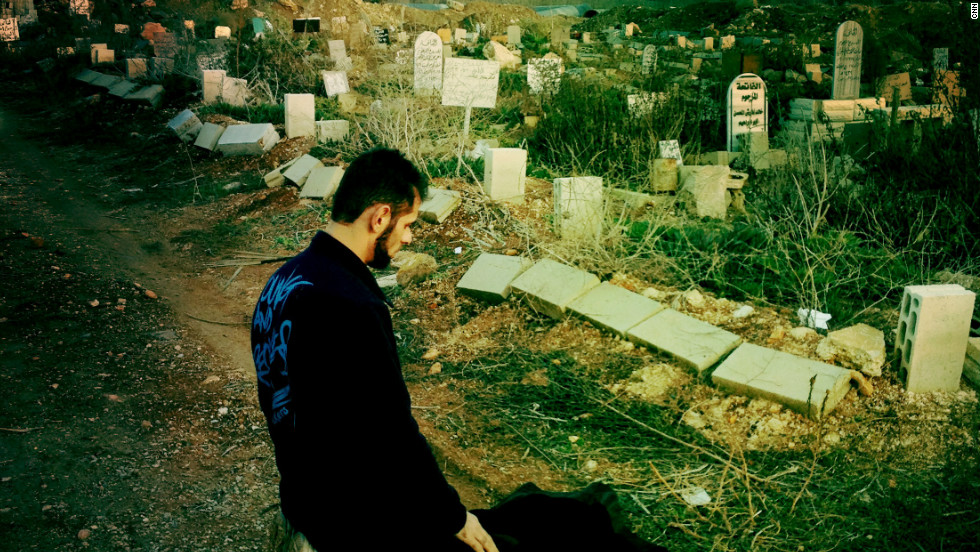 A man prays at the Baba Amr cemetery in Homs as government forces tighten their siege of rebellious neighborhoods.