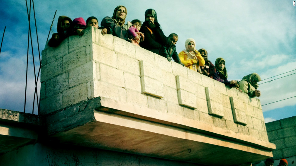 "Women watch over the funeral procession for ""Malik"" in Dar al-Kabira."