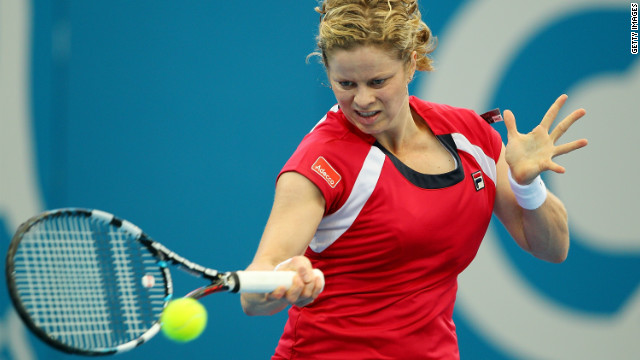 Kim Clijsters plays a return during her straight sets win over Simona Halep in Brisbane.