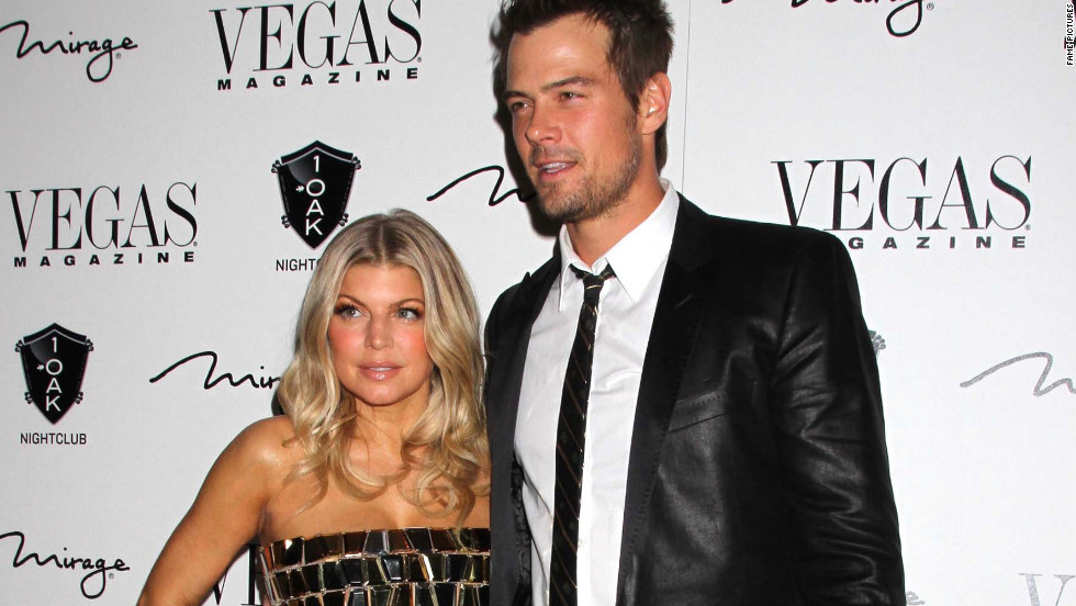 Fergie and Josh Duhamel attend an opening in Las Vegas.
