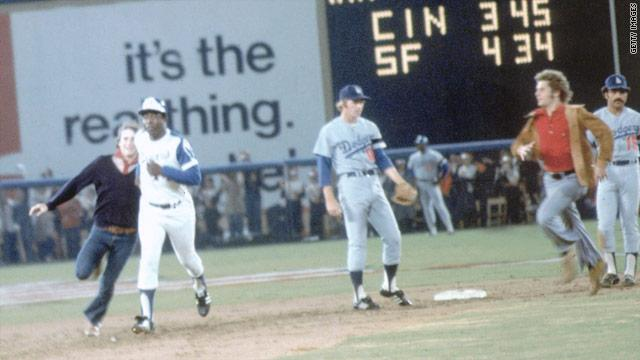Hank Aaron -- and two young men -- rounded the bases after Aaron hit a record-breaking home run in 1974.