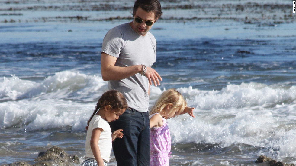 Olivier Martinez goes to the beach with his family in Malibu.