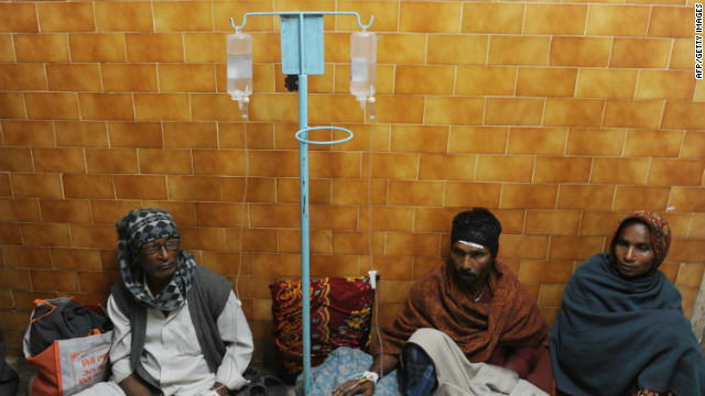 Alcohol poisoning patients receive medical treatment in Diamond Harbour, India, after drinking bootlegged liquor in December 2011