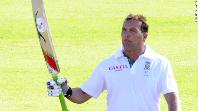 Jacques Kallis waves his bat to celebrate reaching his century in the third Test against Sri Lanka in Cape Town.
