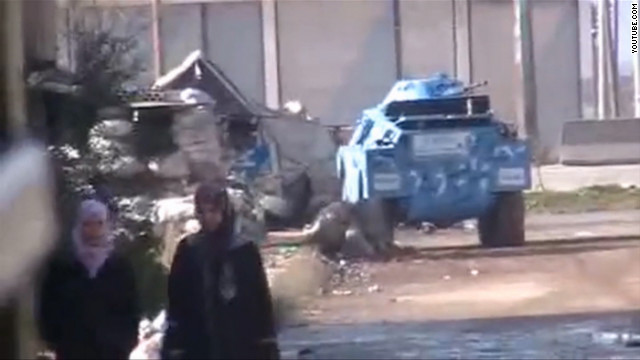 Syrian police tank sits in a neighborhood in Talbise, just north of Homs on January 3, 2012.