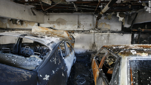 Cars that were burned in a spree of arson fires lie in ruins on January 2, 2012 in Los Angeles, California.