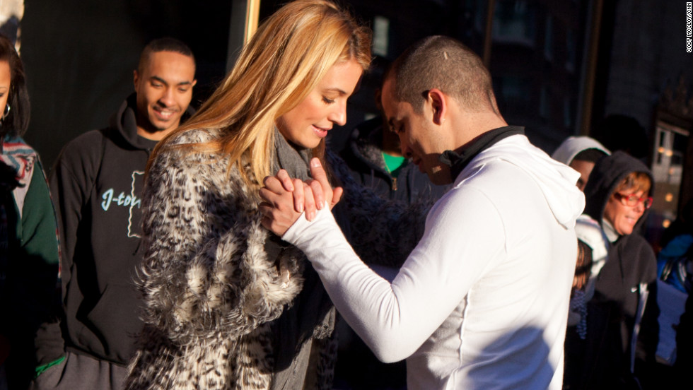 Cat Deeley takes a moment to get some dance pointers from one of the people waiting in line for auditions.