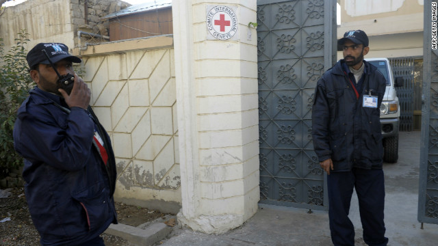 Security guards stand outside the office of the International Committee of the Red Cross in Quetta, Pakistan, on Thursday.