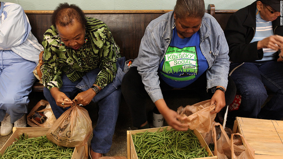 Co-op members pack fresh vegetables.  The income gap is on full display at the Georgia Avenue Food Cooperative, nestled in the heart of Atlanta's historic Grant Park, a bustling, gentrified neighborhood. Ninety-three percent of the co-op members live in poverty, says founder Chad Hale.