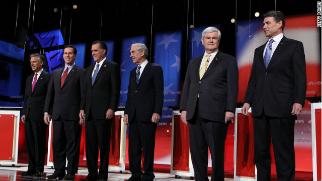 The six major Republican presidential candidates gather on stage before Sunday's debate in Concord, New Hampshire.