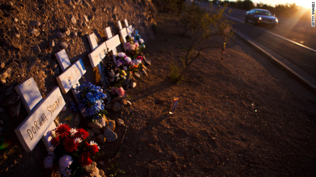 A memorial rests on a highway for six people who lost their lives in a shooting last year in Tucson, Arizona.
