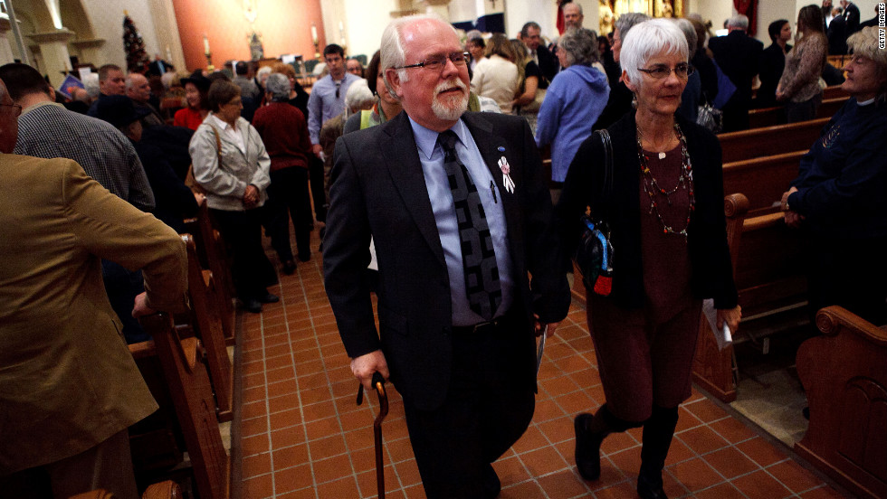 Ron Barber, who was wounded in last year's shooting, exits after attending an Sunday's interfaith service.
