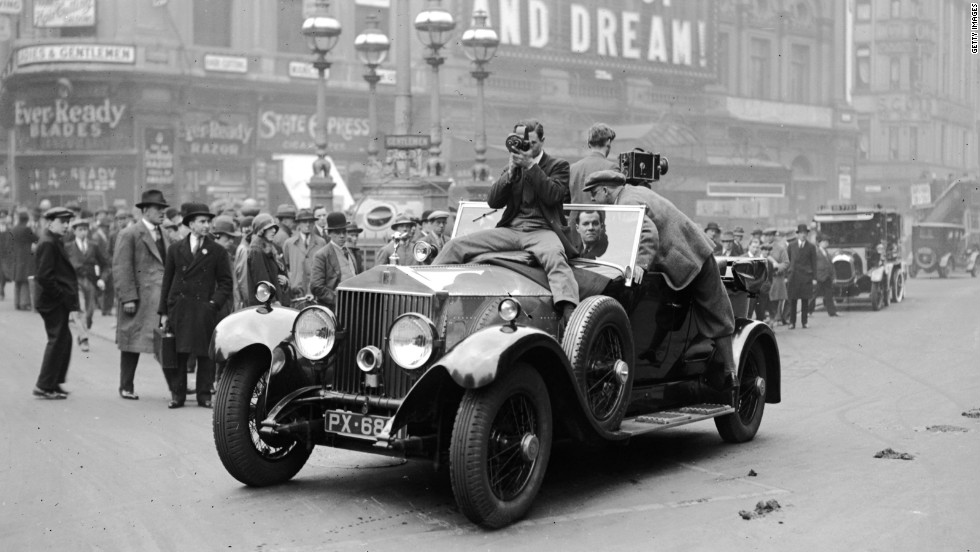 Rolls-Royce cars were valued for their reliability despite their high price. Here cameramen film from a Rolls-Royce in Piccadilly, London, in April 1929.