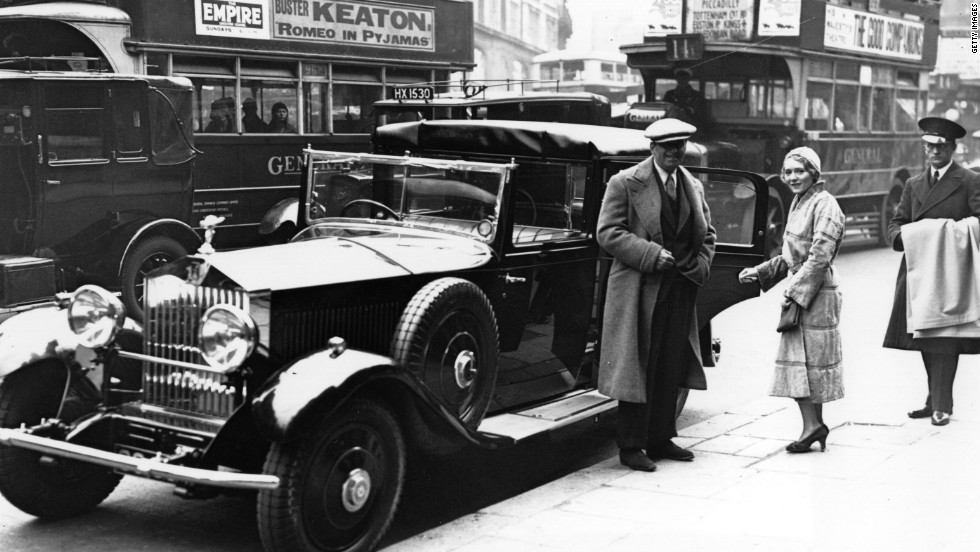 The ultimate in glamor: U.S. acting couple Douglas Fairbanks Jr. and Mary Pickford stand beside their chauffeur-driven Rolls-Royce in London in 1931.