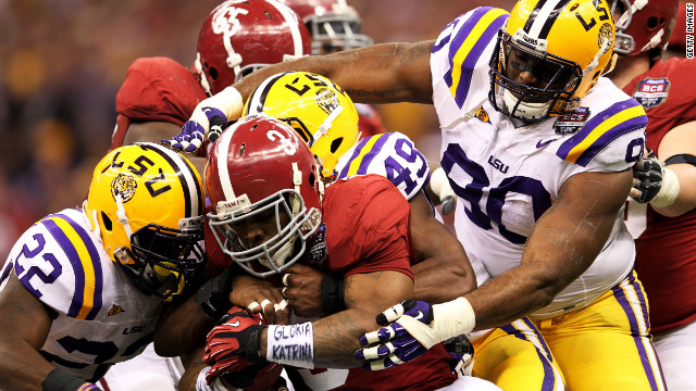 Alabama's Trent Richardson gets tackled during Monday night's BCS National Championship Game against  LSU.