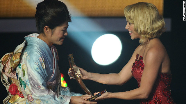 Homare Sawa (left) receives the FIFA Women's World Player of the Year award from Colombian singer Shakira.