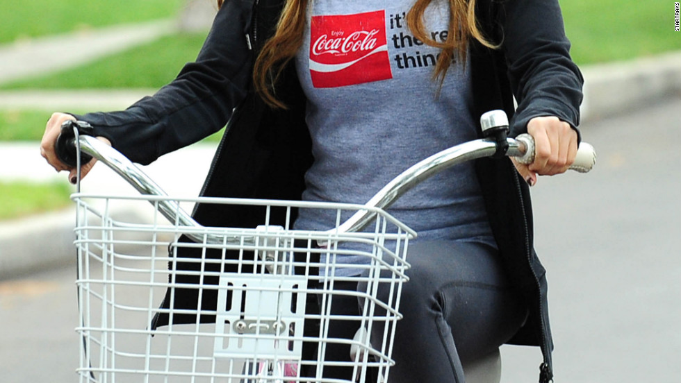 Ashley Tisdale rides her bike in Los Angeles.