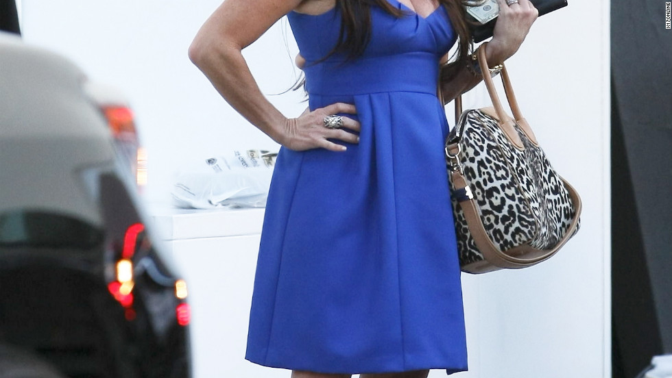 Kyle Richards waits for her car in Beverly Hills.