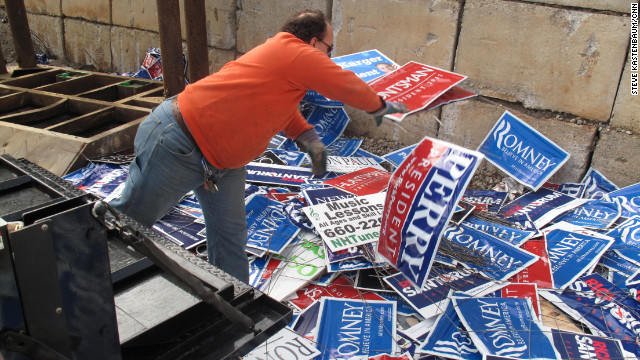 The campaigns left behind hundreds of political signs on street corners in New Hampshire. Now someone has to pick them all up.