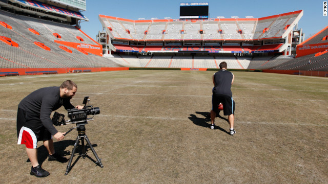 Chase Heavener films Tim Tebow's workout at the University of Florida's Ben Hill Griffin Stadium.