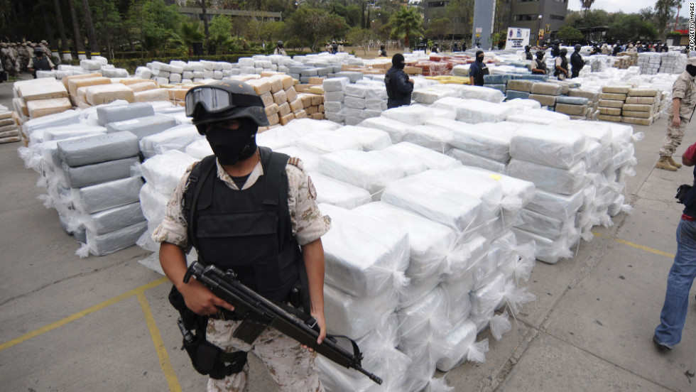 Mexican Federal Police stand guard over 105 tons of marijuana seized in Tijuana, Mexico, in October 2010. Smuggling remains a booming business. For example, south of the border it costs $2,000 to produce a kilo of cocaine from leaf to lab, according to the DEA. In America, a kilo's street value is significantly higher.