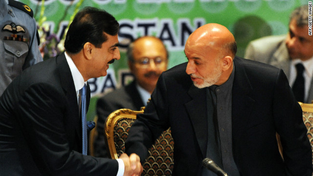 Pakistani PM Yousuf Raza Gilani, left, and Afghan President Hamid Karzai meet at a conference in Islamabad in May 2009.