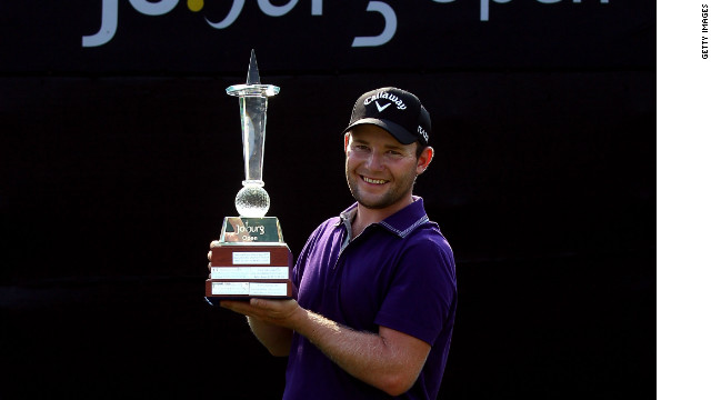 Branden Grace shows off his Joburg Open trophy after claiming the first European Tour win of his career.