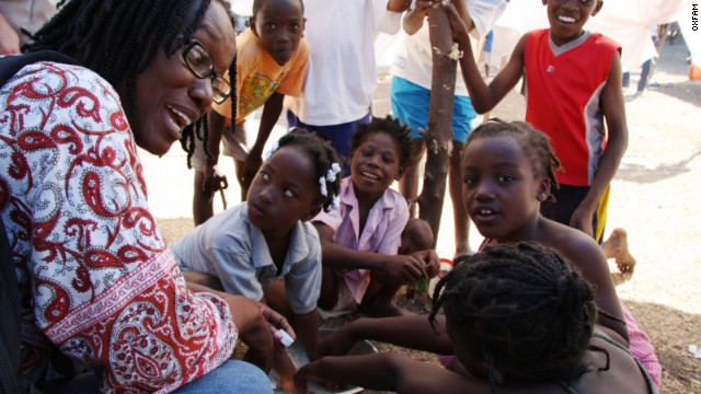 Yolette Etienne, here with children in Haiti, says civic participation and community projects are crucial to recovery