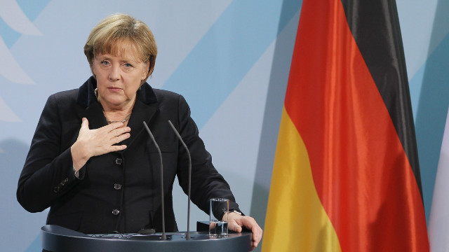 German Chancellor Angela Merkel speaks to the media following talks with Italian Prime Minister Mario Monti in Berlin in 2011