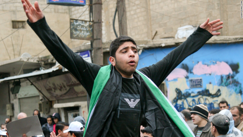 A young anti-Assad protester leads the crowd in chants in the southern town of Kisweh, Syria, on Tuesday, January 17. Access to Syria has been extremely limited, but a CNN crew was in Syria in January 2011 and captured these images.