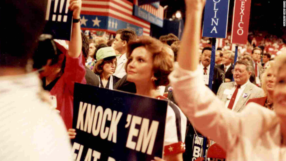 "Costa holds a ""Knock 'Em Flat Pat"" sign during Robertson's address to the 1992 Republican National Convention in Houston."