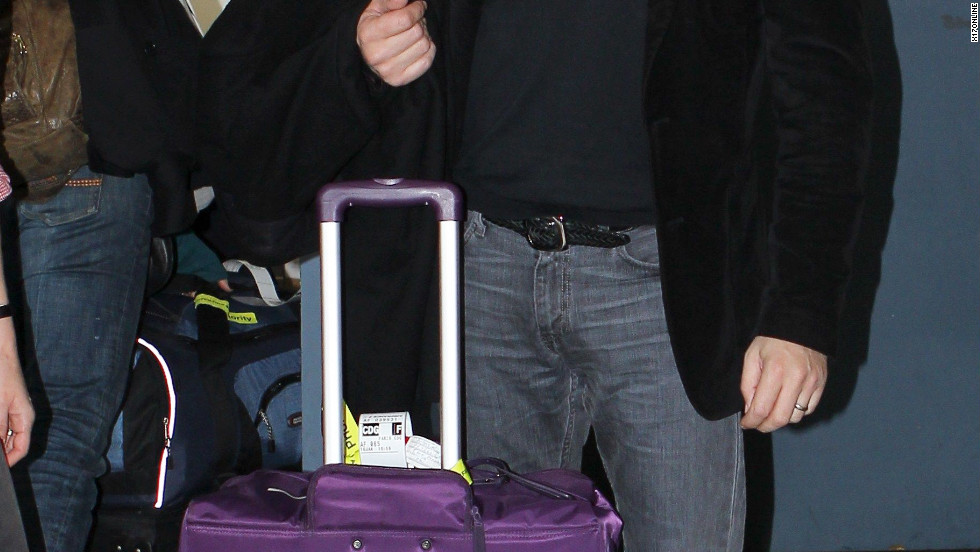 Jean Dujardin catches a flight from the airport in Los Angeles.