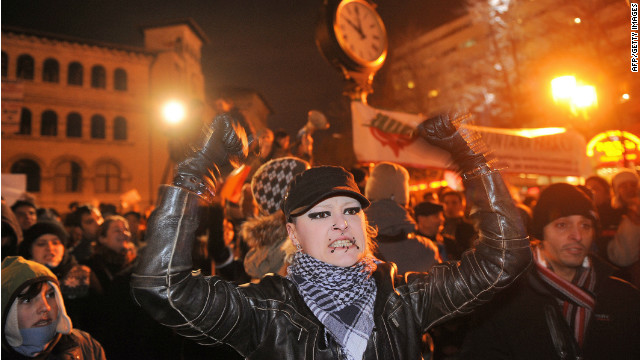 A protester gestures during an anti-presidential rally in Bucharest on January 17, 2012.