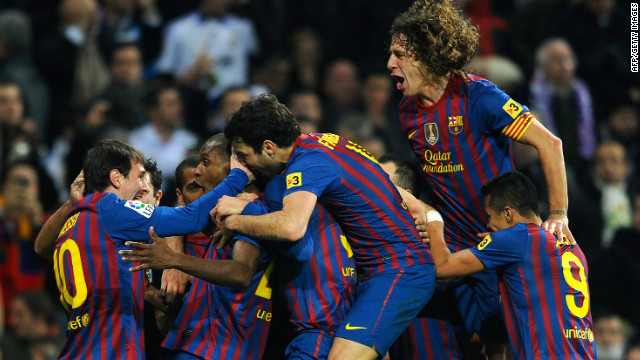 Eric Abidal celebrates after his goal secured a 2-1 victory for Barcelona over Real Madrid in the Spanish Cup.