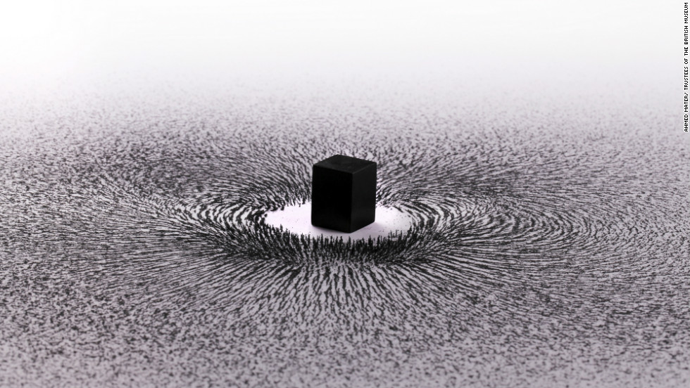 New artwork by Saudi artist Ahmed Mater using a magnet and iron filings to represent people circling the Ka'ba in Mecca.
