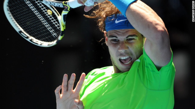 Spanish tennis star Rafael Nadal hits a return during his win against Germany's Tommy Haas.