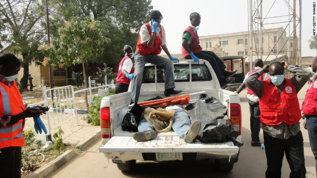 Rescue workers carry the bodies of victims killed by multiple explosions and armed assailants in the Marhaba area of the northern Nigerian city of Kano into the morgue at the Murtala Mohammed Specialist Hospital, on January 21, 2012. Coordinated bomb attacks on January 20 targeting security forces and gun battles have killed at least 121 people in Nigeria's second-largest city of Kano, with bodies littering the streets.