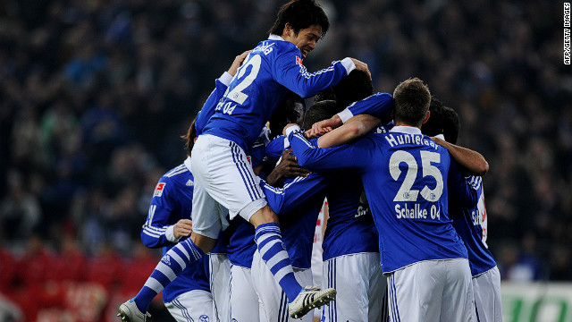 Schalke players celebrate a goal during a 3-1 win over Stuttgart in the Bundesliga on Saturday