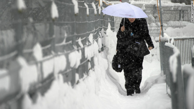 A woman walks to the Congress center hosting the World Economic Forum (WEF) in Davos, Switzerland on January 24, 2012.