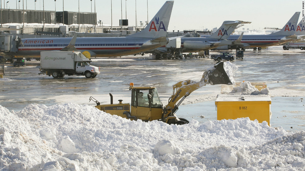 Workers remove snow at Chicago O'Hare International Airport on February 3, 2011.