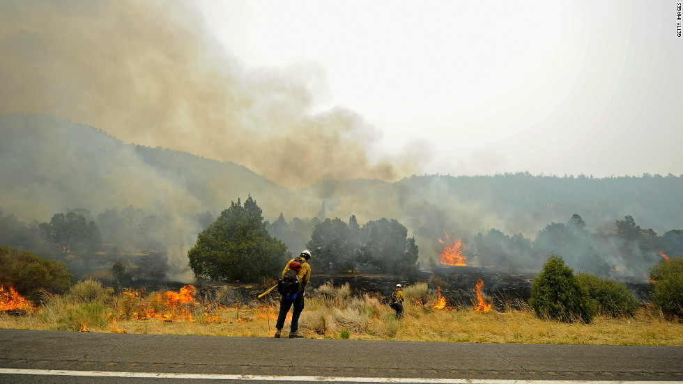 Firefighters attempt to contain a wildfire in Nutrioso, Arizona, in 2011.