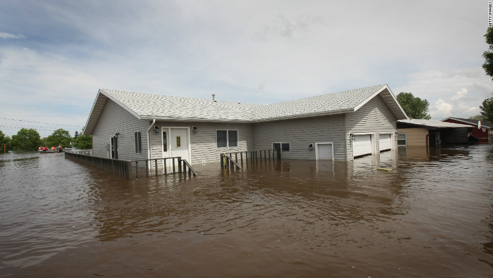 A home is surrounded by floodwaters in Burlington, North Dakota, on June 26, 2011.