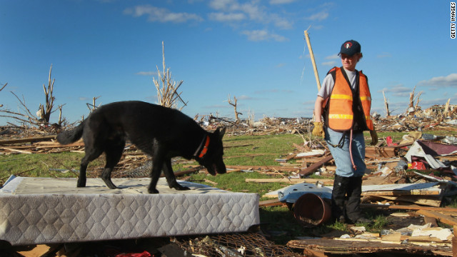 A search team looks for possible victims from the tornado that hit Joplin, Missouri, in May 2011.