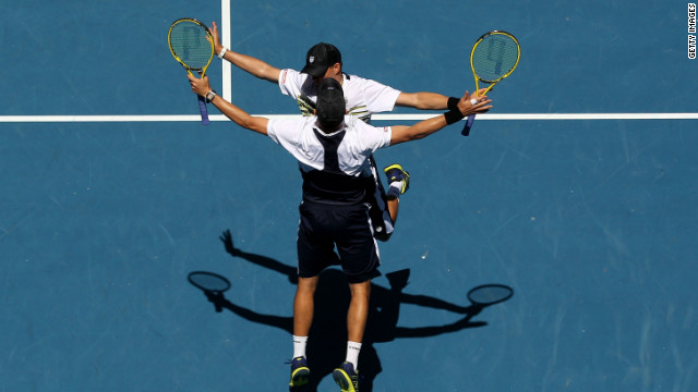 Bob and Mike Bryan perform their customary chest bump after their semifinal win on Thursday.